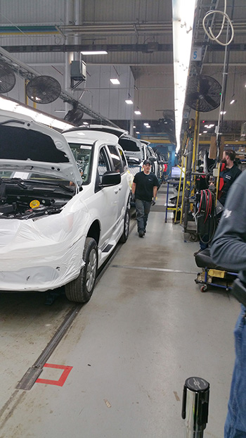 Minivans being built in factory photo