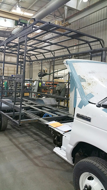 Minibus being built in factory photo