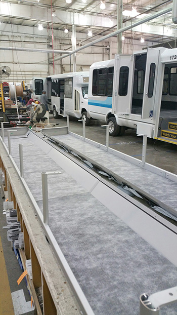 Minibuses being built in factory photo